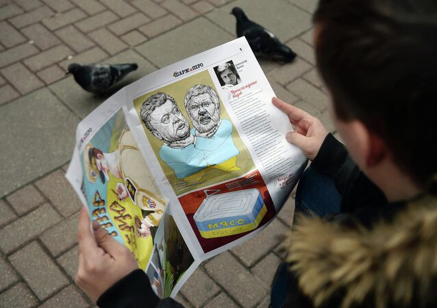 Young man reading a caricature newspaper