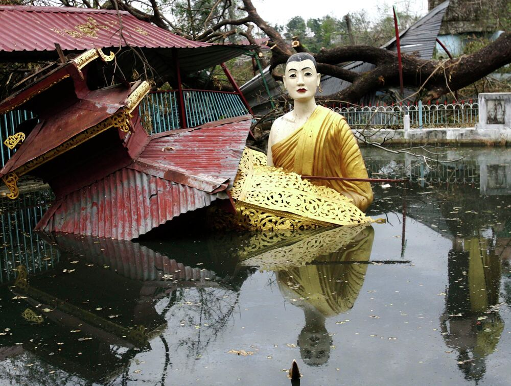 A large statue of Buddha sits in water at a temple that was heavily damaged by cyclone Nargis, that hit Myanmar in 2008 and left at least 140,000 people dead or missing.