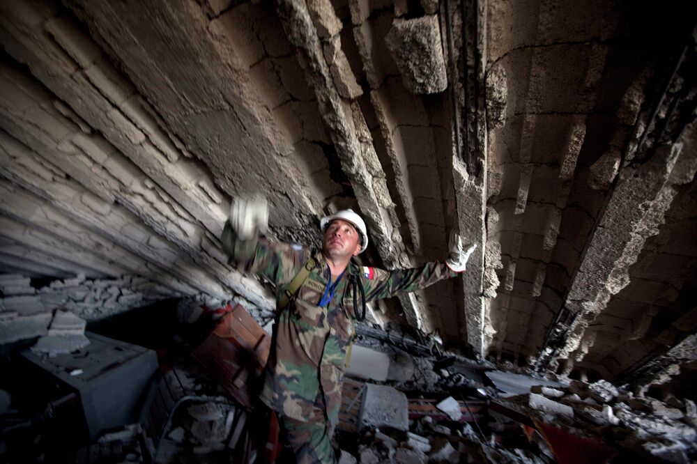 A Chilean UN peacekeeper works in the rubble of the Montana Hotel searching for victims of the earthquake in Port-au-Prince in 2010 after a 7.0-magnitude earthquake struck Haiti, carrying away more than 220,000 lives.