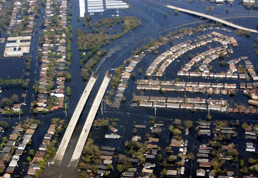 The damage from hurricane Katrina near New Orleans is seen from Air Force One. In 2005 hurricane Katrina, the largest and third strongest hurricane ever recorded to make landfall in the US, left 1,300 people dead.
