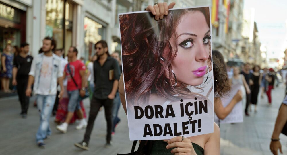 People march with a photograph of Dora Oezer, a transsexual Turkish woman, who according to local media was killed in Kusadasi, to protest violence against members of the gay and transsexual community members, in Istanbul, Turkey, Friday, July 12, 2013. File Photo