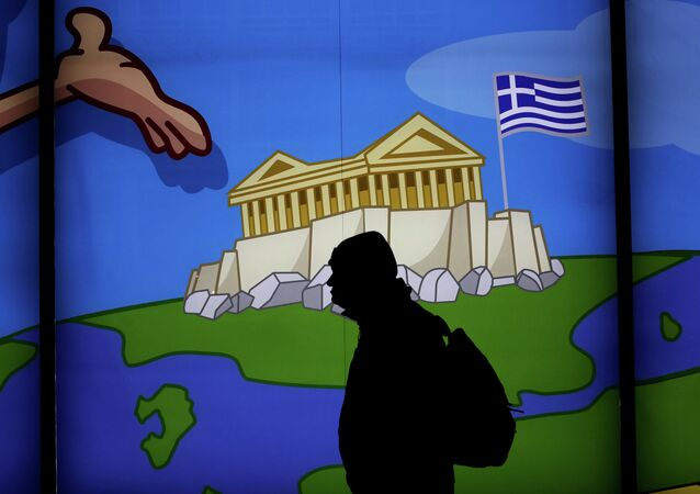 A man walks past a shop with a display window featuring the Acropolis in Athens , on March 14, 2105