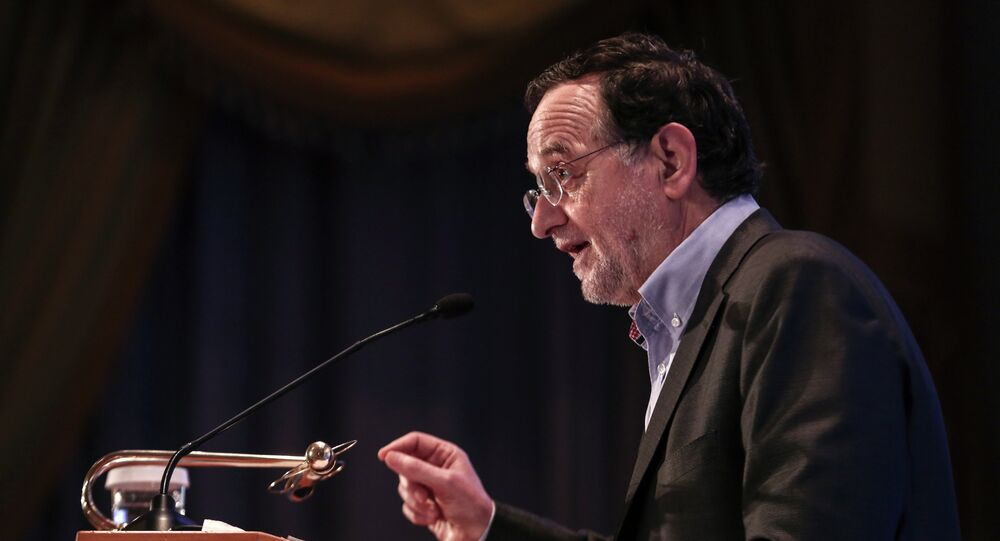 Greece's energy and environment minister Panagiotis Lafazanis addresses the audience during an energy conference in Athens, on Wednesday, March 11, 2015