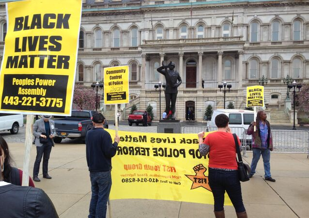 Demonstrators protest the death of Freddie Gray outside Baltimore City Hall on Monday, April 20, 2015.