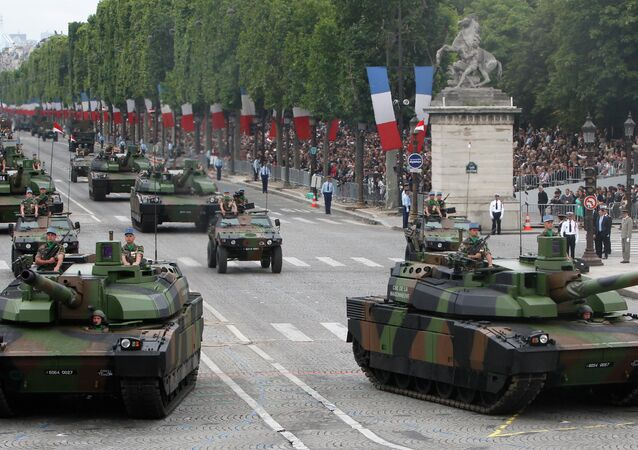 Leclerc tanks drive down the Bastille Day parade on the Champs-Elysees.