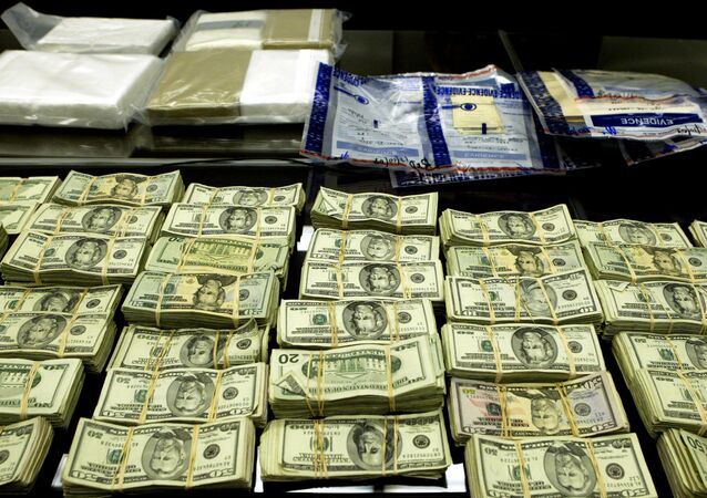 Cocaine and cash seized by the FBI during an investigation of a Mexican-based drug cartel is displayed during a press conference at the Dirksen Federal Building Monday, Dec. 13, 2004, in Chicago. File Photo