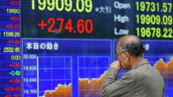 A man looks at an electronic stock indicator of a securities firm in Tokyo  - Sputnik International
