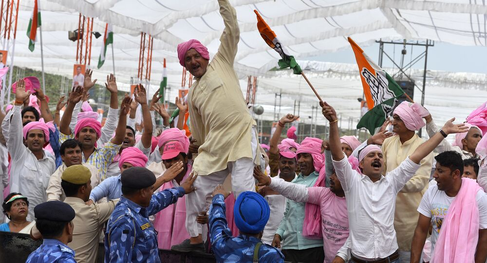 Indian Congress Party supporters shout slogans during a rally in New Delhi on April 19, 2015