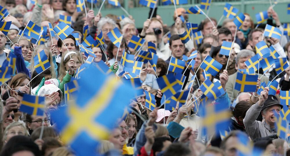 Swedes wave flags at the Skansen open-air museum in Stockholm on 6 June 2005 to celebrate National Day.