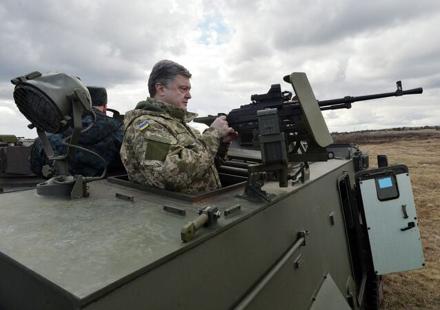Ukrainian President Petro Poroshenko examines a British-made Saxon armored personnel carrier with a Ukrainian weapon system while visiting a military base outside Kiev on April 4, 2015