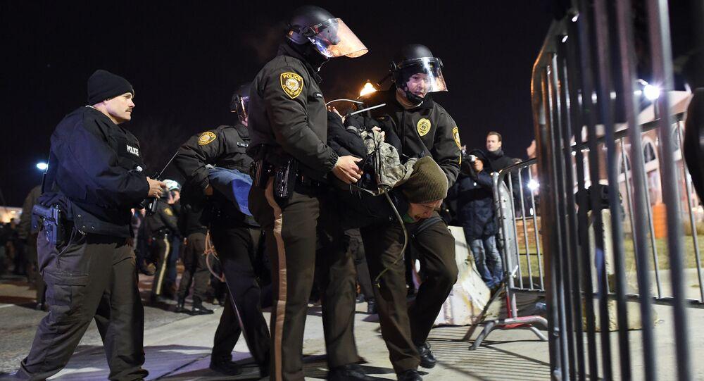 Police detain a protester outside the police station in Ferguson, Missouri, on November 25, 2014