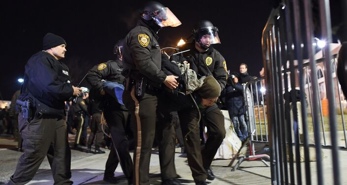 Police detain a protester outside the police station in Ferguson, Missouri, on November 25, 2014