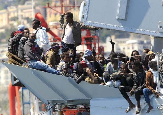 Migrants stand on board of Italian Navy ship Chimera before to be disembarked in the southern harbour of Salerno April 22, 2015