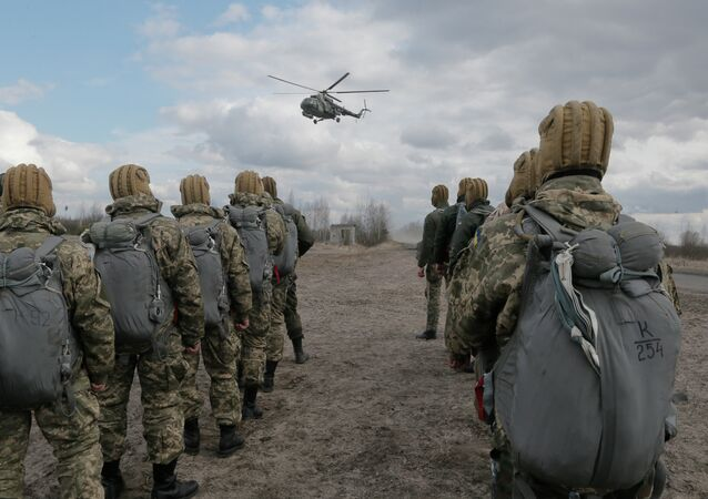 Ukrainian army soldiers perform a military exercise at a training ground outside Zhitomir, Ukraine