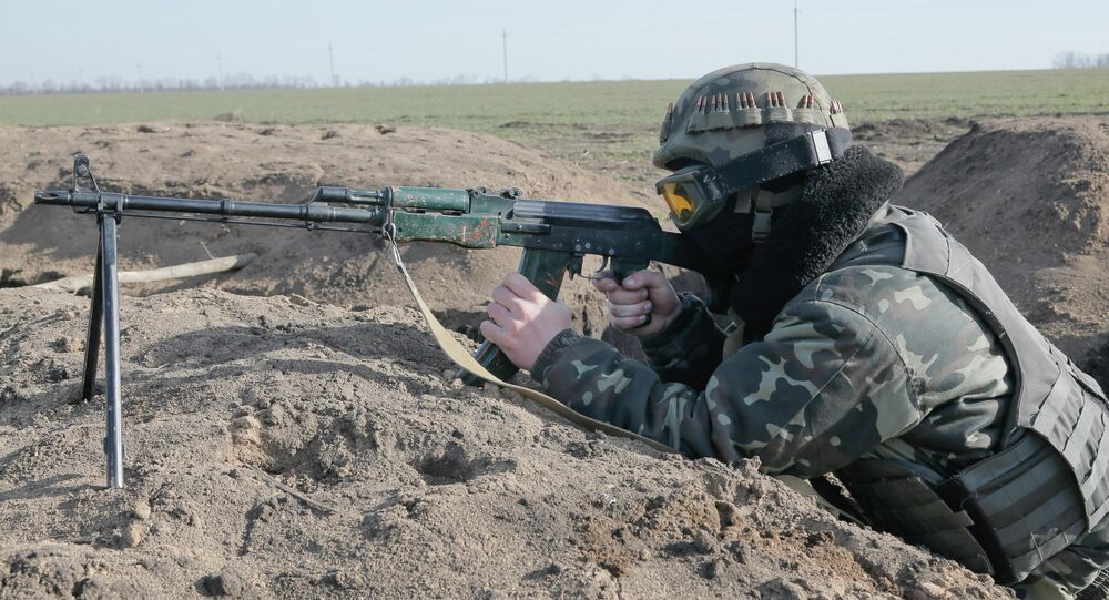 A Ukrainian serviceman takes position at the front line outside Kurahovo, in the Donetsk region of Ukraine