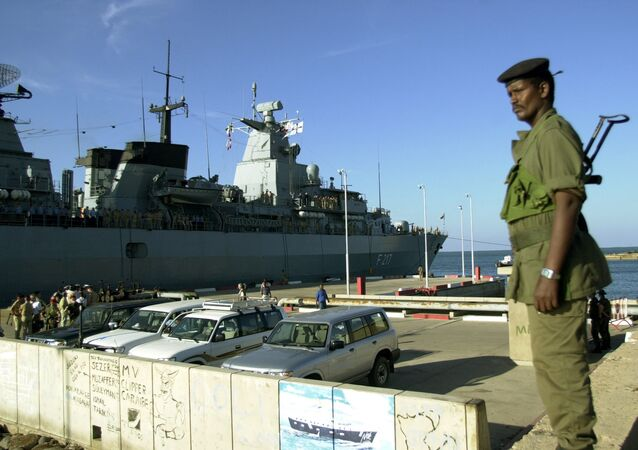 A Djiboutian soldier stands at the Port of Djibouti.