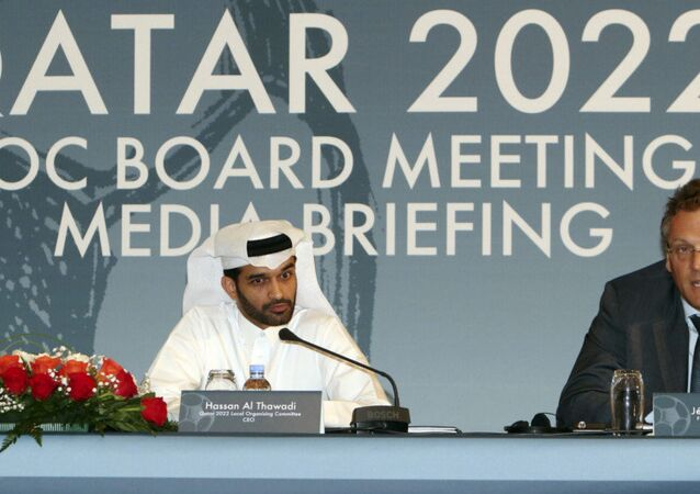 Hassan Al Thawadi, head of the Qatar 2022 World Cup organizing committee, center, and FIFA Secretary General Jerome Valcke give a press conference, in Doha.