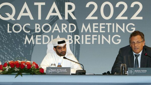 Hassan Al Thawadi, head of the Qatar 2022 World Cup organizing committee, center, and FIFA Secretary General Jerome Valcke give a press conference, in Doha. - Sputnik International