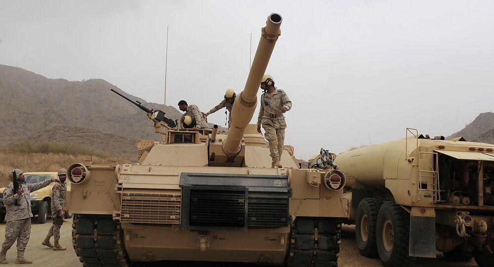 Saudi soldiers are seen on top of their tank deployed at the Saudi-Yemeni border, in Saudi Arabia's southwestern Jizan province