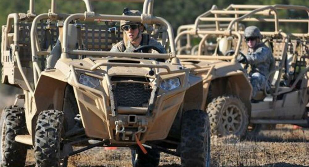 US Army paratroopers drive Light Tactical All Terrain Vehicles (LTATV) through a familiarization course on Fort Bragg, North Carolina.