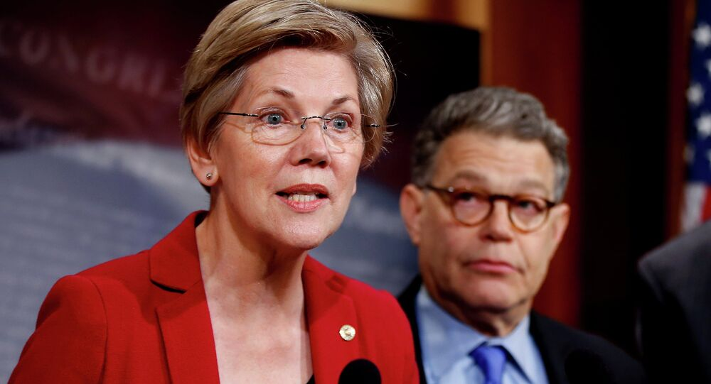 Sen. Elizabeth Warren, D-Mass, left, speaks at a new conference on Capitol Hill in Washington.