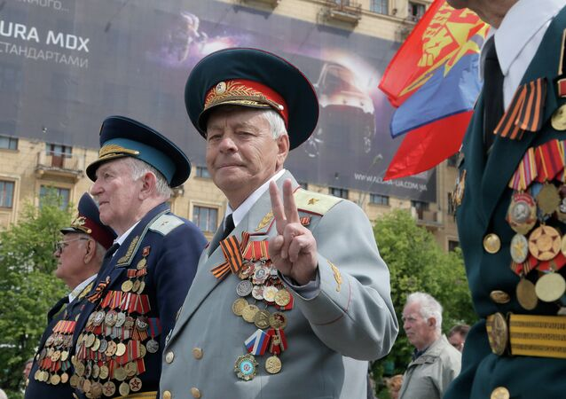 Former Soviet Union army veterans march during a Victory Day celebration, which commemorates the 1945 defeat of Nazi Germany, in the center of Kharkiv, Ukraine, Friday, May 9, 2014