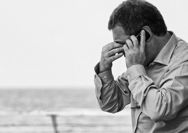 A man speaking on the phone