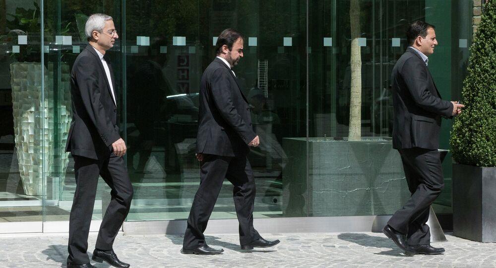 Iran's ambassador to the IAEA (International Atomic Energy Agency), Reza Najafi (C) leaves Coburg Palace during the E3/EU+3 and Iran talks in Vienna