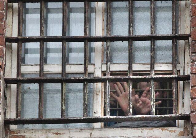 Prisoners in the prison window