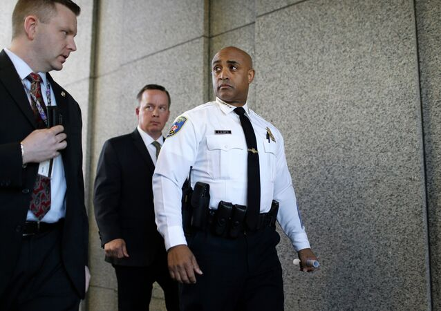 Baltimore Police Department Commissioner Anthony Batts, center, leaves a news conference after speaking about the investigation into Freddie Gray's death.