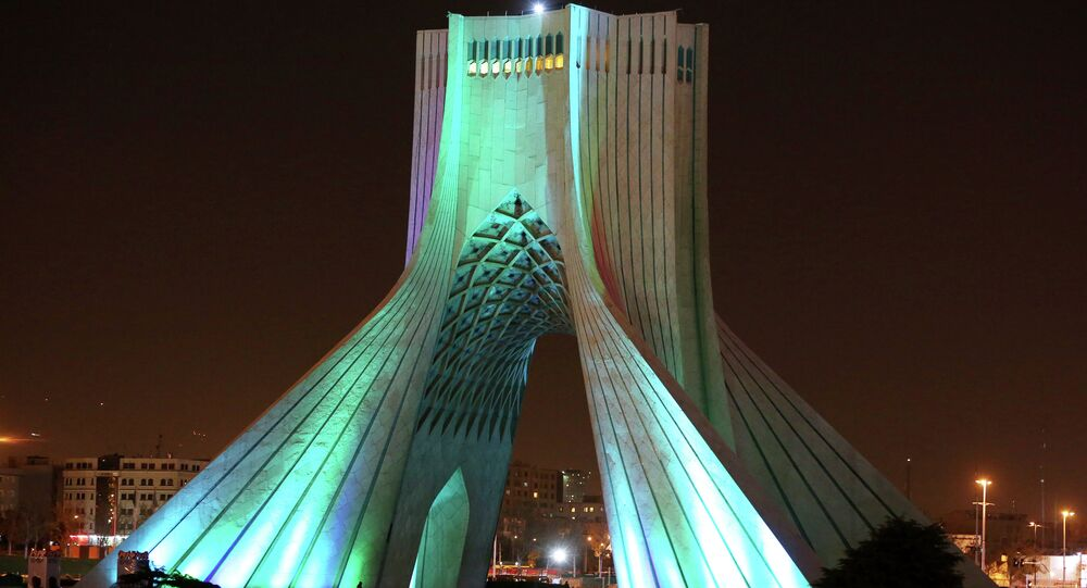 The Azadi (Freedom) tower is illuminated before the lights were turned off during the worldwide Earth Hour in Tehran, Iran, Saturday, March 29, 2014.