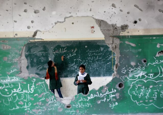 Palestinian girls play inside their school which was destroyed during the 50 days of conflict between Israel and Hamas last summer, in the Shejaiya neighborhood of Gaza City, on November 5, 2014