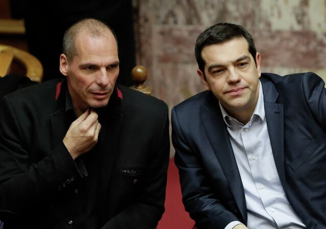Greece's Prime Minister Alexis Tsipras, right, and Finance Minister Yanis Varoufakis attend a Presidential vote in Athens, on Wednesday, Feb. 18, 2015
