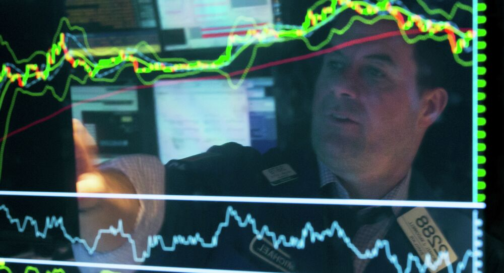 Specialist Michael McDonnell is reflected in a screen at his post on the floor of the New York Stock Exchange, Friday, March 20, 2015