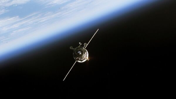 In this 11 June, 2003 NASA image an unmanned Progress supply vehicle (L), backdropped by the blackness of space and Earth's horizon, approaches the Pirs Docking Compartment (out of frame) attached to the Zvezda Service Module on the International Space Station (ISS) - Sputnik International