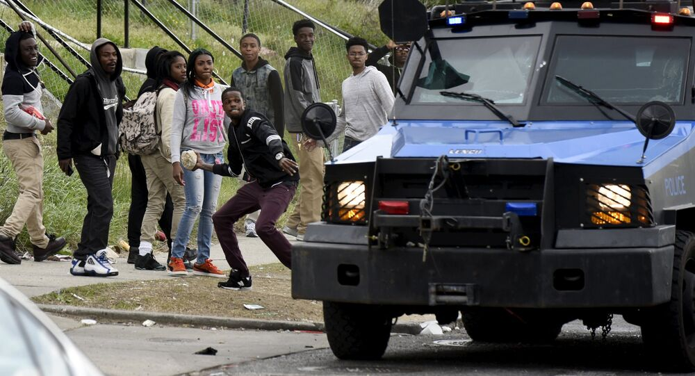 Protesters clash with police near Mondawmin Mall after Freddie Gray's funeral in Baltimore April 27, 2015