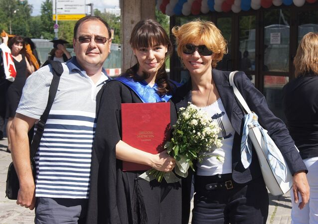 Maria Yakovleva, center, with her parents