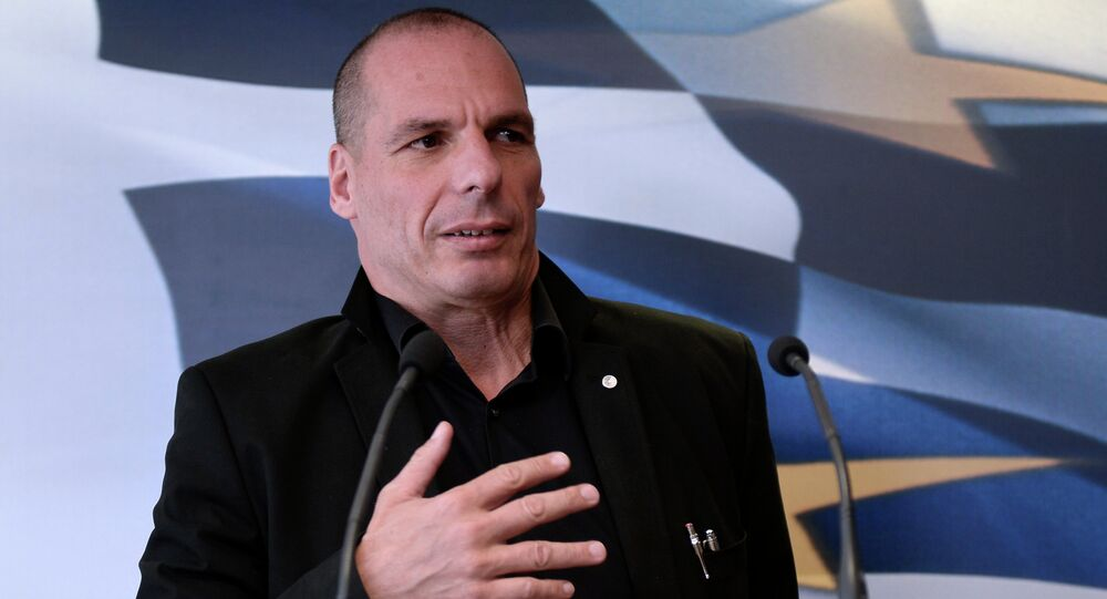 Greek Finance Minister Yianis Varoufakis briefs the media after his meeting with Swiss Deputy Minister for International Financial Affairs Jacques de Watteville in Athens on April 28, 2015