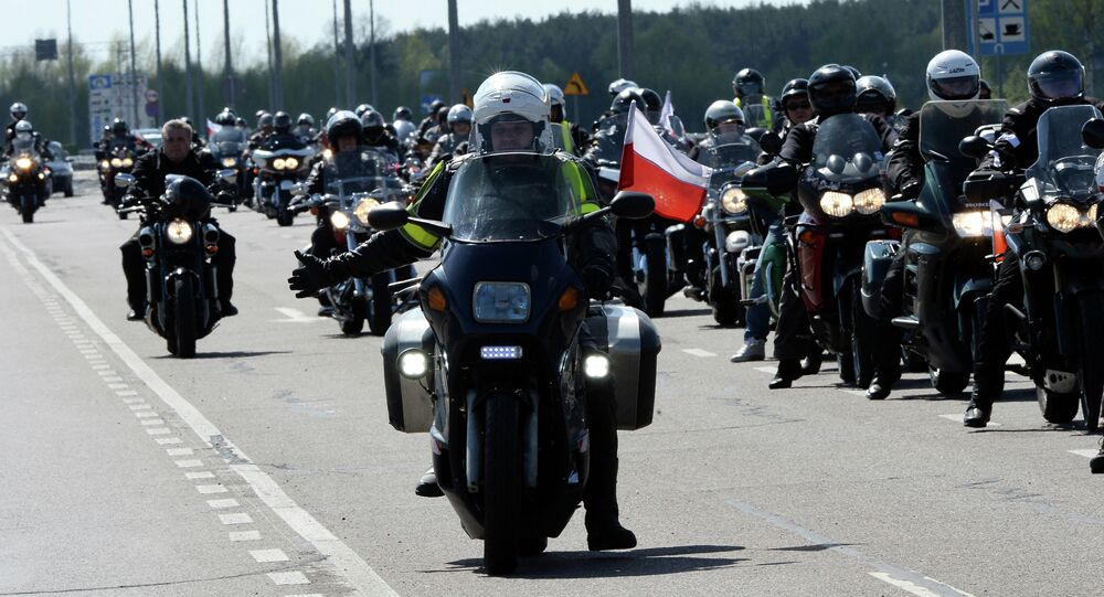 Polish bikers supporters of Russian motorcycling group Night Wolves flash lights and honk horns as a protest after Russian bikers were refused entry to Poland in Terespol on April 27, 2015