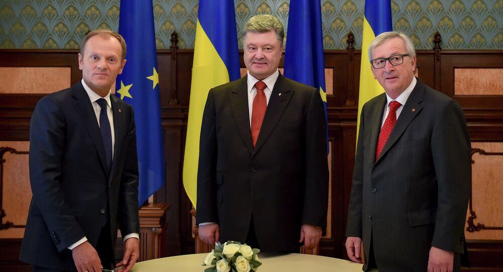 Ukrainian President Petro Poroshenko, center, European Council President Donald Tusk, left, and European Commission President Jean-Claude Juncker