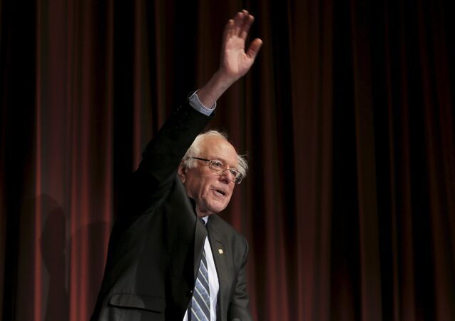 U.S. Senator Bernie Sanders (D-VT) waves to the audience before speaking at the opening of the 2015 National Action Network Convention in New York City