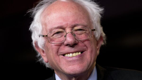 Sen. Bernie Sanders, I-Vt., smiles as he is asked about running for president during a news conference on Capitol Hill in Washington, Wednesday - Sputnik International