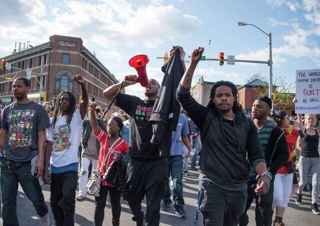 Demonstrators chant on Pennsylvania Avenue in Baltimore, Maryland, April 28, 2015