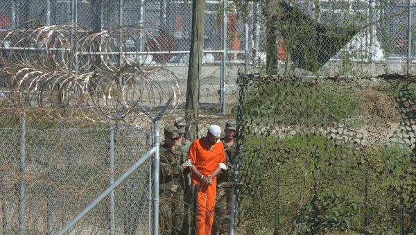 A detainee is escorted to interrogation by U.S. military guards at Camp X-Ray at Guantanamo Bay. - Sputnik International