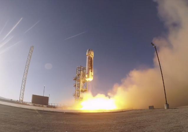Jeff Bezos test-launches a suborbital rocket.