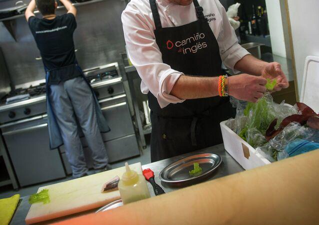 Spanish chef prepares a dish