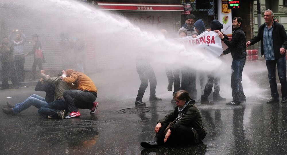 Turkish police use water cannon to disperse protestors during a May Day rally near Taksim Square in Istanbul on May 1, 2015