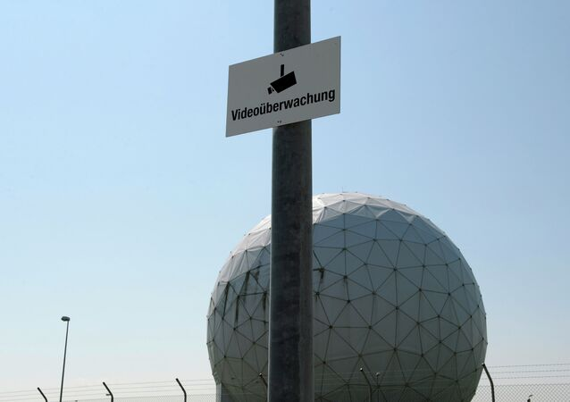 A photo taken on July 16, 2013 shows a sign reading video surveillance fixed to a lamp post in front of radomes of the former monitoring base of the US intelligence organization National Security Agency (NSA) in Bad Aibling, southern Germany