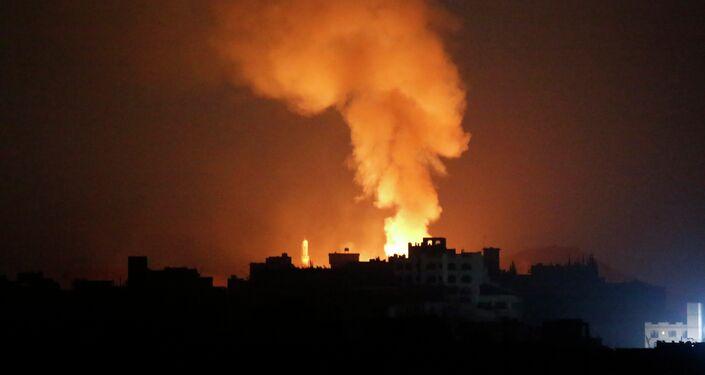 Fire and smoke rises after a Saudi-led airstrike on Sanaa, Yemen, Tuesday, April 28, 2015