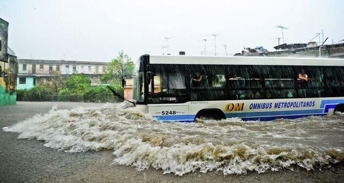 A transport bus wades along a flooded street during an intense rainstorm in Havana.